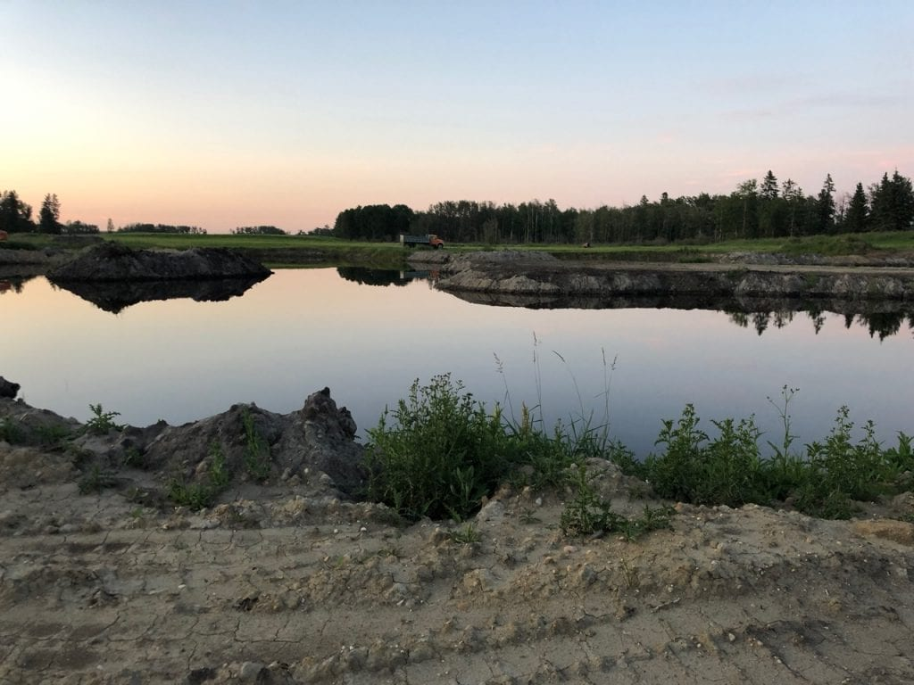 View of pool of water for Club Mead Labrador Retriever Training grounds and Property